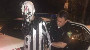 Creepy 'clown' found lurking in the woods is arrested by US police